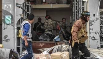 عمليات نهب في عفرين على أيدي مسلحين مدعومين من تركيا